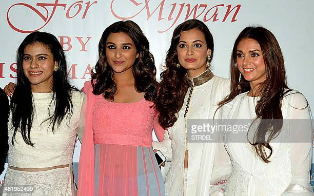 Indian Bollywood actresses Kajol Devgn Parineeti Chopra Dia Mirza and Aditi Rao Hydar pose for a photograph during a charity fashion show in Mumbai...