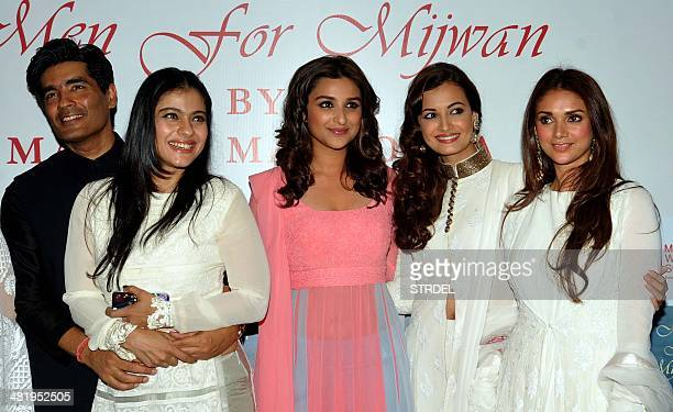 Indian Bollywood actresses Kajol Devgn Parineeti Chopra Dia Mirza and Aditi Rao Hydar and designer Manish Malhotra pose for a photograph during a...