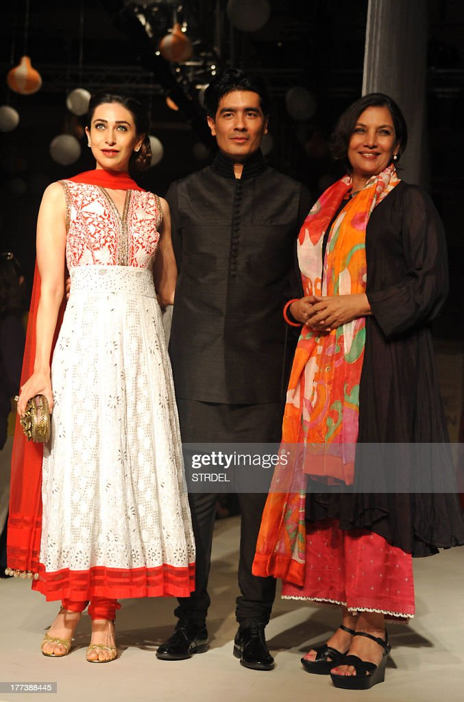 Indian Bollywood actresses Karishma Kapoor (L) and Shabana Azmi (L) pose with designer by Manish Malhotra during the Lakme Fashion Week (LFW) Winter/Festival 2013 in Mumbai on August 22, 2013.