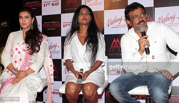 Indian Bollywood actresses Lisa Ray and Usha Jadhavlook on as director Ram Gopal Varmaaddresses media during the trailer launch of the forthcoming...