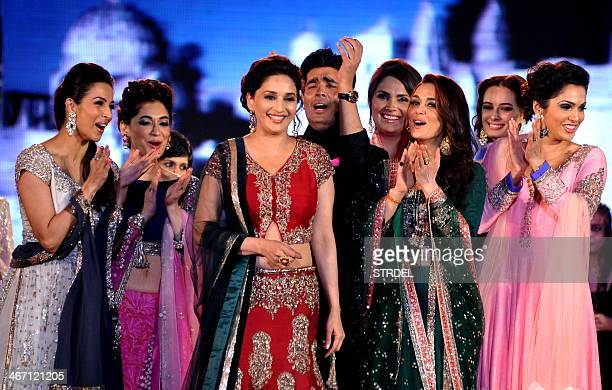 Indian Bollywood actresses Malaika Arora Khan Madhuri Dixit Nene Lara Dutta Preity ZintaEvelyn Sharma and Isha Koppikar pose as they display...