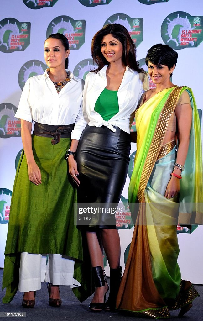 Indian Bollywood actresses <a gi-track='captionPersonalityLinkClicked' href=/galleries/search?phrase=Neha+Dhupia&family=editorial&specificpeople=2195000 ng-click='$event.stopPropagation()'>Neha Dhupia</a> (L), <a gi-track='captionPersonalityLinkClicked' href=/galleries/search?phrase=Shilpa+Shetty&family=editorial&specificpeople=565509 ng-click='$event.stopPropagation()'>Shilpa Shetty</a> (C) and <a gi-track='captionPersonalityLinkClicked' href=/galleries/search?phrase=Mandira+Bedi&family=editorial&specificpeople=703799 ng-click='$event.stopPropagation()'>Mandira Bedi</a> pose for a photograph during a promotional event in Mumbai on January 8, 2015.