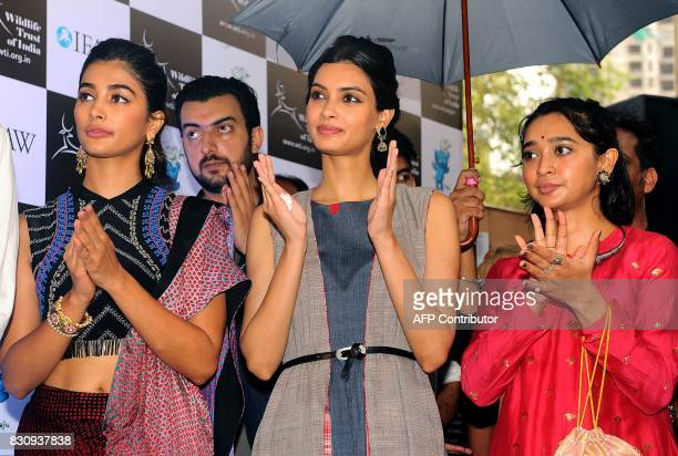Indian Bollywood actresses Pooja Hegde Diana Penty and Sayani Gupta pose for a photograph during the launch of Gaj Yatra a campaign to save India's...