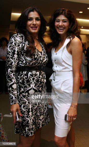 Indian Bollywood actresses Raveena Tandon and Pooja Batra pose at the opening of an exhibition at The Museum Art Gallery in Mumbai late June 28...