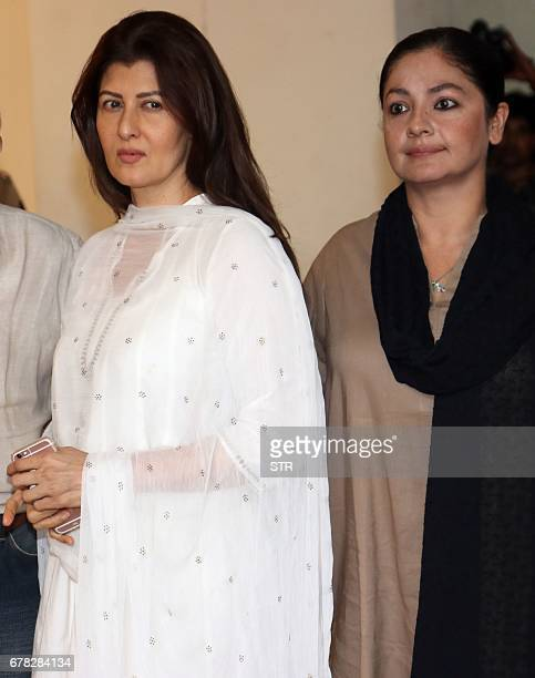 Indian Bollywood actresses Sangeeta Bijlani and Pooja Bhatt arrive to attend a prayer meeting for the late actor and politician Vinod Khanna in...