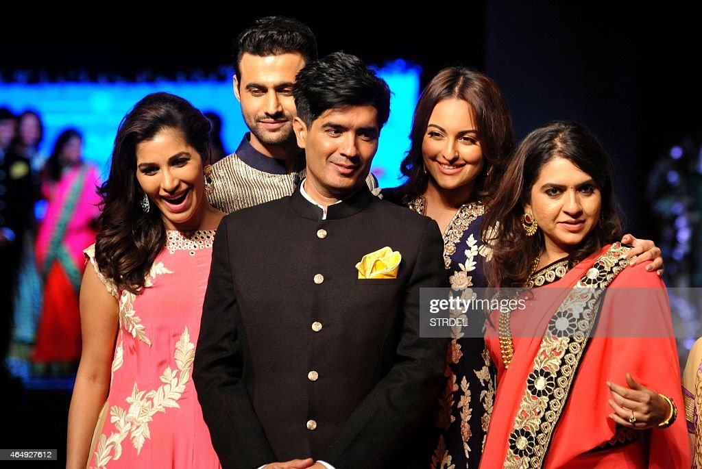Indian Bollywood actresses <a gi-track='captionPersonalityLinkClicked' href=/galleries/search?phrase=Sophie+Choudry&family=editorial&specificpeople=6598413 ng-click='$event.stopPropagation()'>Sophie Choudry</a> (L) and <a gi-track='captionPersonalityLinkClicked' href=/galleries/search?phrase=Sonakshi+Sinha&family=editorial&specificpeople=5781347 ng-click='$event.stopPropagation()'>Sonakshi Sinha</a> (2R) pose with designers <a gi-track='captionPersonalityLinkClicked' href=/galleries/search?phrase=Manish+Malhotra+-+Fashion+Designer&family=editorial&specificpeople=4458343 ng-click='$event.stopPropagation()'>Manish Malhotra</a> (C) and Shaina NC (R) during the tenth annual Caring with Style fashion show in association with The Cancer Patients Aid Association in Mumbai late March 1, 2015.