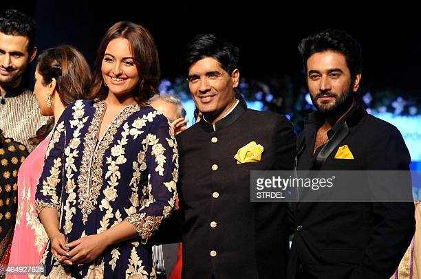 Indian Bollywood actresses Sophie Choudry and Sonakshi Sinha pose with designer Manish Malhotra and music director Shekhar during the tenth annual...