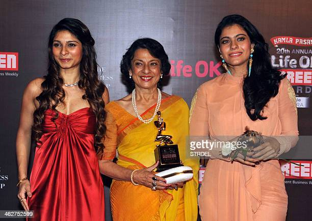 Indian Bollywood actresses Tanisha Mukherjee Tanuja Mukherjee and Kajol Devgn pose for a photograph during the Life OK Screen Awards 2014 ceremony in...