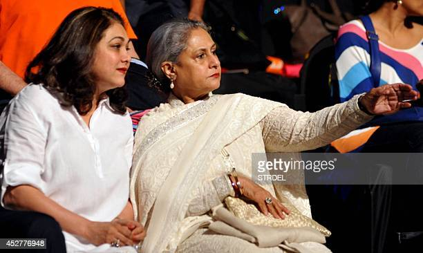 Indian Bollywood actresses Tina Ambani and Jaya Bachchan look on during a professional kabaddi league match in Mumbai on late July 26 2014 AFP...