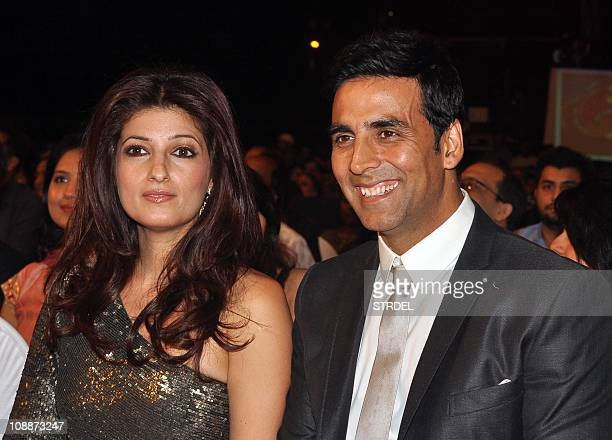 Indian Bollywood Akshay Kumar and wife Twinkle Khanna look on as they attend the 'Stardust Awards 2011' ceremony in Mumbai on February 6 2011 AFP...