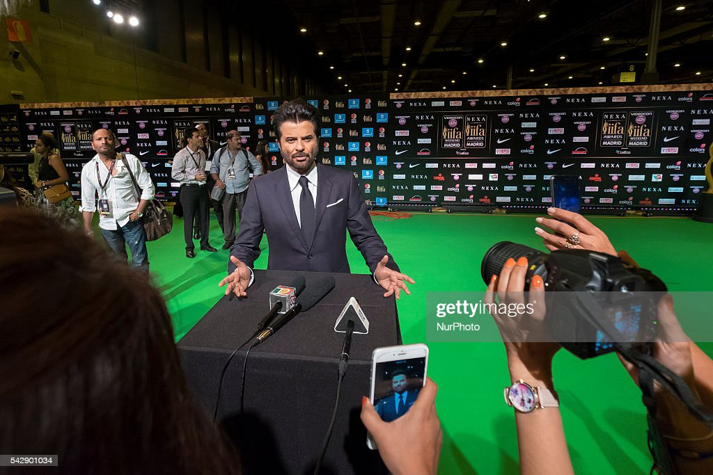 Indian Bollywood <a gi-track='captionPersonalityLinkClicked' href=/galleries/search?phrase=Anil+Kapoor&family=editorial&specificpeople=563857 ng-click='$event.stopPropagation()'>Anil Kapoor</a> poses on the green carpet as she arrives to the 17th edition of IIFA Awards (International Indian Film Academy Awards) in Madrid on June 24, 2016.