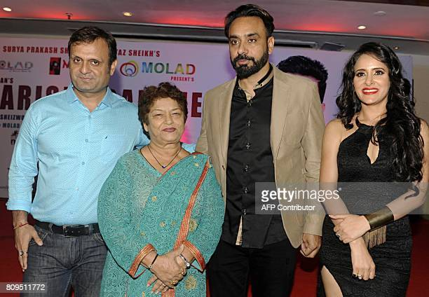 Indian Bollywood choreographers Saroj Khan Punjabi singer Babbu Maan and actress Shweta Khanduri pose for a photograph during a promotional event for...