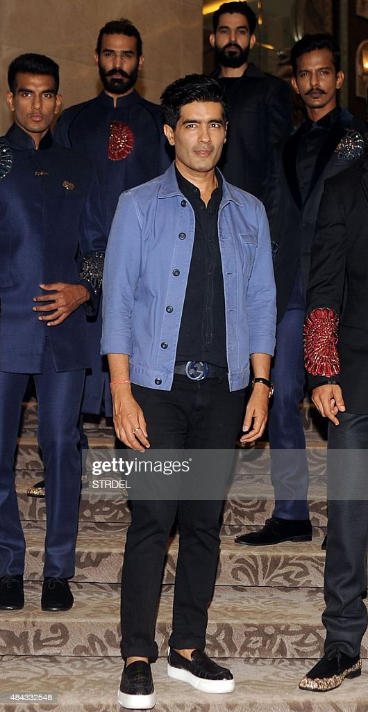 Indian Bollywood designer <a gi-track='captionPersonalityLinkClicked' href=/galleries/search?phrase=Manish+Malhotra+-+Fashion+Designer&family=editorial&specificpeople=4458343 ng-click='$event.stopPropagation()'>Manish Malhotra</a> (C) and menswear models pose for a photograph during a promotional event for the first menswear show and preview for the forthcoming Lakme Fashion Week Winter/Festival 2015 in Mumbai on August 17, 2015. AFP PHOTO / STR