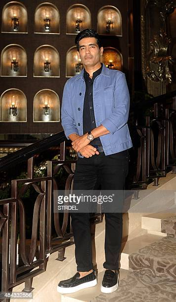 Indian Bollywood designer Manish Malhotra poses for a photograph during a promotional event for the first menswear show and preview for the...