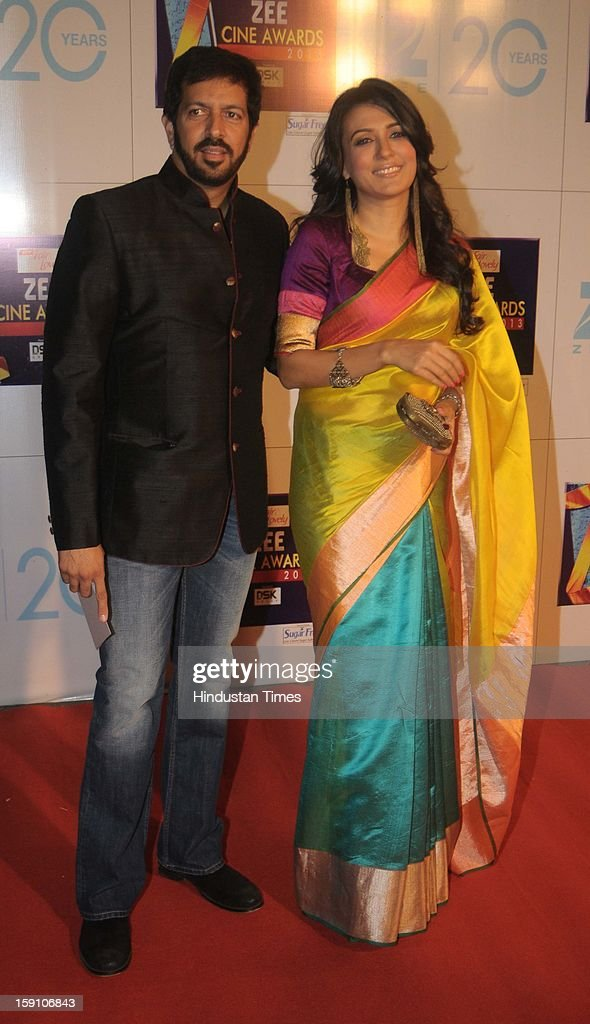 Indian bollywood director Kabir Khan with his wife Mini Mathur attending Zee Cine Awards 2013 at Yash Raj Studio on January 6, 2013 in Mumbai, India.