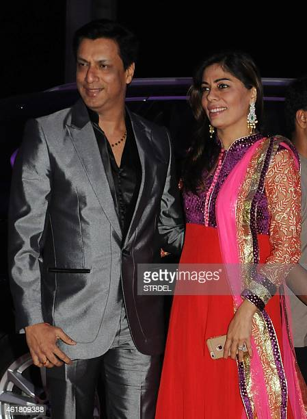 Indian Bollywood director Madhur Bhandarkar with his wife attend the wedding reception of Kussh Sinha son of Bollywood veteran actor Shatrughan Sinha...