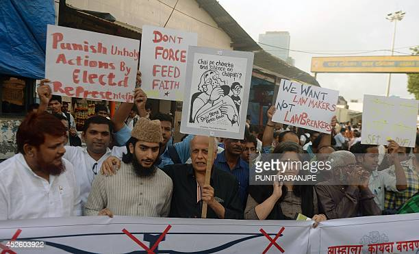 Indian Bollywood director Mahesh Bhatt and Indian activists hold placards during a protest against the Shiv Sena party in Mumbai on July 24 2014...