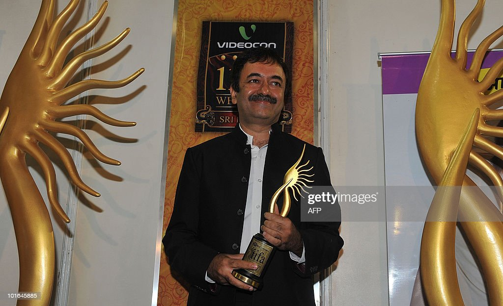 Indian Bollywood director Rajkumar Hirani poses with a trophy after receiving best screenplay award for his film '3 Idiots' at the International Indian Film Academy (IIFA) awards in Colombo on June 5, 2010. Bollywood actors arrived in Sri Lanka to attend the three-day International Indian Film Academy (IIFA) awards and surrounding events that begun in Colombo on June 3.