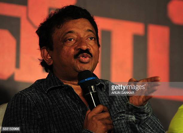 Indian Bollywood director Ram Gopal Varma gestures as he addresses media representatives during a promotional event for the film 'Veerapan' in...