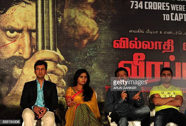 Indian Bollywood director Ram Gopal Varmasits alongside actress Usha Jadhavand actors Sandeep Bhardwajand Sachin Joshias he speaks at media briefing...