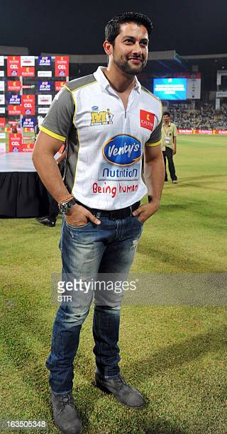 Indian Bollywood film actor Aftab Shivadasani poses during the Celebrity Cricket League 2013 Finals between Karnataka Bulldozers and Telugu Warriors...