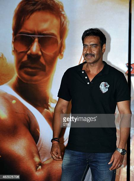 Indian Bollywood film actor Ajay Devgn poses during the trailer launch of the upcoming Hindi film 'Singham Returns' directed by Rohit Shetty and...