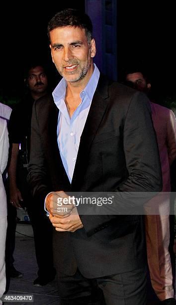 Indian Bollywood film actor Akshay Kumar attends the wedding reception of Bollywood film producer Smita Thackeray's son Rahul Thackeray and his wife...