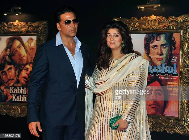 Indian Bollywood film actor Akshy Kumar and his wife Twinkle Khanna pose on the red carpet at the premiere of the Hindi film 'Jab Tak Hai Jaan' in...