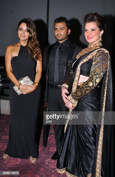 Indian Bollywood film actor and producer Sachin Joshi poses with wife and film actress Urvashi Sharma and producer/interior designer Gauri Khan...