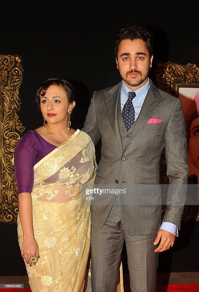 Indian Bollywood film actor Imran Khan (R) and his wife Avantika Malik pose on the red carpet at the premiere of the Hindi film 'Jab Tak Hai Jaan' in Mumbai on November 12, 2012.