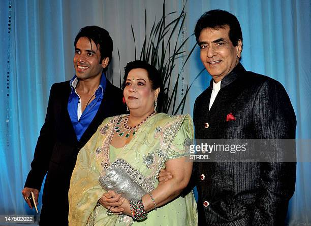 Indian Bollywood film actor Jitendra wife Shobha and son Tushar Kapoor pose during the wedding reception of film actress Esha Deol and husband Bharat...