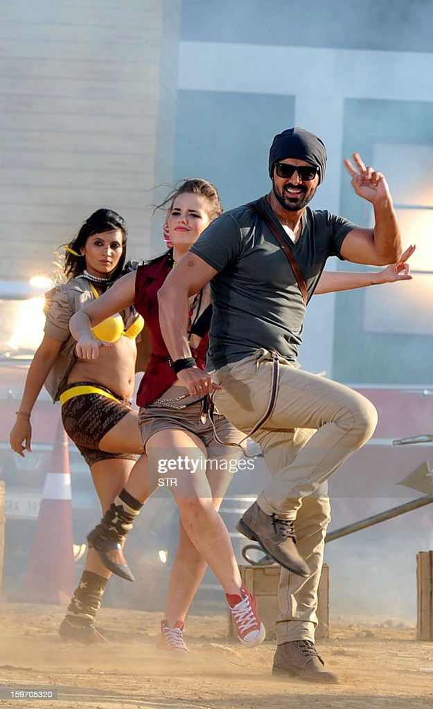 Indian Bollywood film actor John Abraham performs on location during the shooting of the upcoming Hindi film 'I Me Aur Main' song directed by debutant Kapil Sharma at Kamalistan Studio in Mumbai on January 18, 2013. AFP PHOTO