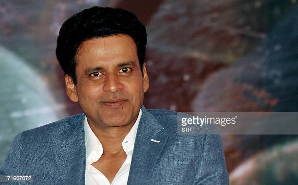 Indian Bollywood film actor Manoj Bajpai poses during a press conference for the promotion of upcoming political thriller Hindi film 'Satyagraha'...