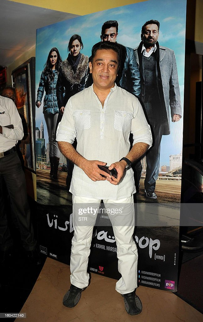 Indian Bollywood film actor producer and director Kamal Haasan poses at a press conference about the controversy regarding his new film...