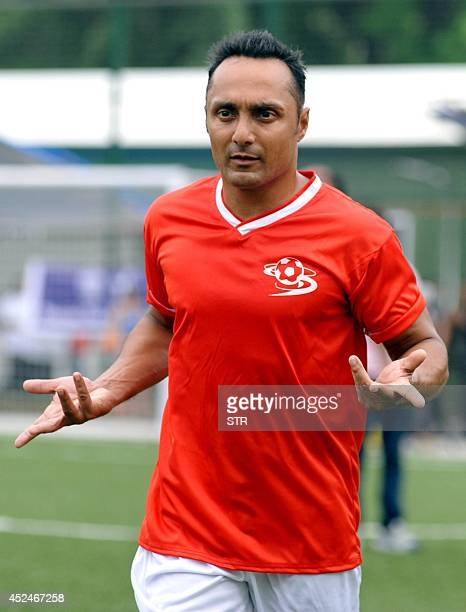 Indian Bollywood film actor Rahul Bose plays during a charity football match organized by Ira Khan daughter of film actor Aamir Khan in Mumbai on...