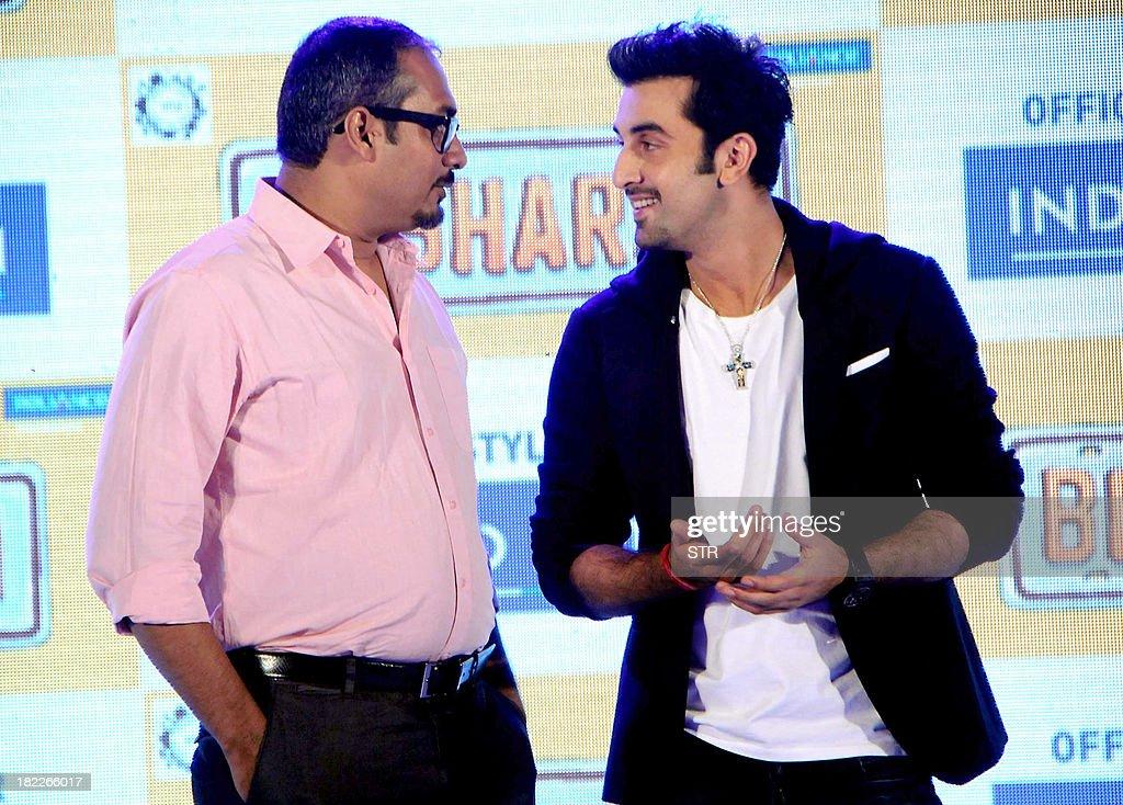 Indian Bollywood film actor Ranbir Kapoor (R) interacts with director Abhinav Singh Kashyap of his upcoming Hindi film 'Besharam', during his birthday celebration in Mumbai on September 28, 2013.