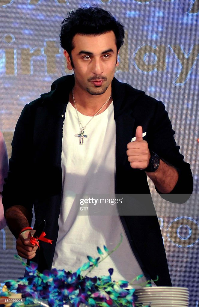 Indian Bollywood film actor Ranbir Kapoor poses during his birthday celebration with promotion for his upcoming Hindi film 'Besharam' directed by Abhinav Singh Kashyap in Mumbai on September 28, 2013.