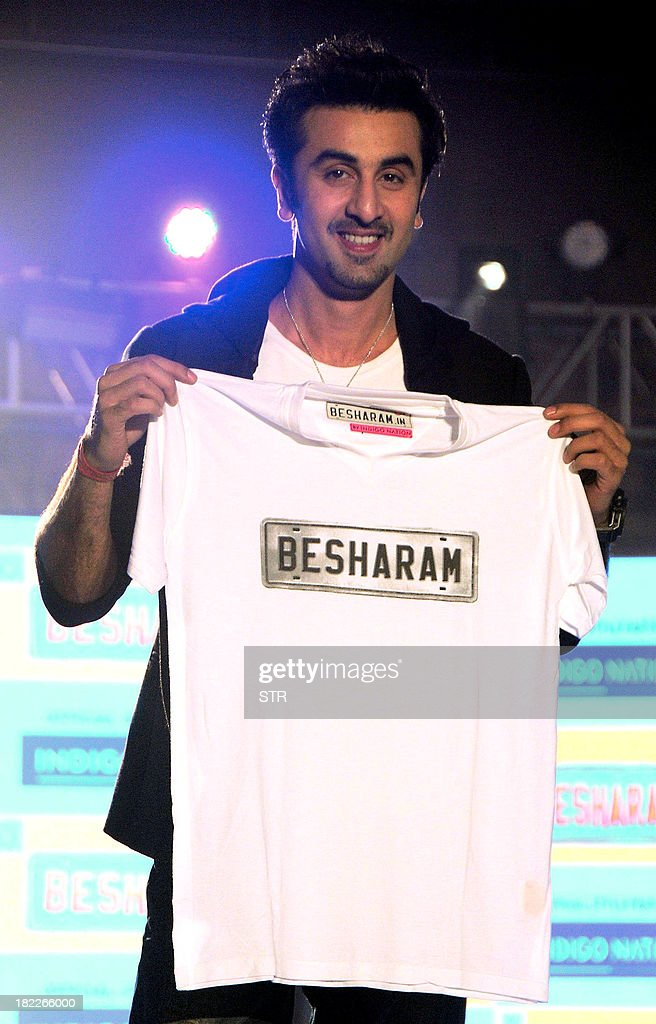 Indian Bollywood film actor Ranbir Kapoor poses with promotional materials for his upcoming Hindi film 'Besharam' directed by Abhinav Singh Kashyap during his birthday celebration in Mumbai on September 28, 2013.