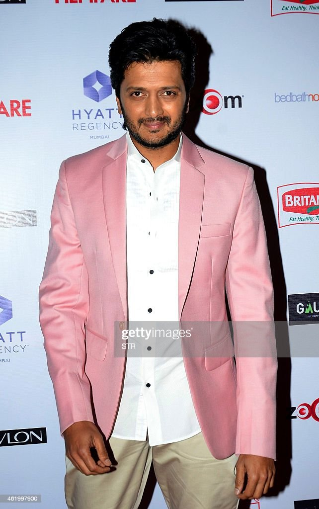 Indian Bollywood film actor <a gi-track='captionPersonalityLinkClicked' href=/galleries/search?phrase=Ritesh+Deshmukh&family=editorial&specificpeople=4141905 ng-click='$event.stopPropagation()'>Ritesh Deshmukh</a> poses at the 60th Britannia 'Filmfare Awards 2014' Pre-Awards Party in Mumbai on January 22, 2015. AFP PHOTO