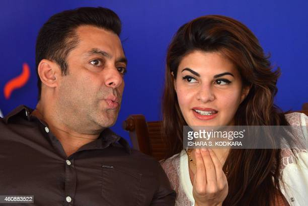 Indian Bollywood film actor Salman Khan chats with Sri Lankan Bollywood film actress Jacqueline Fernandez at a free medical clinic organised to drum...