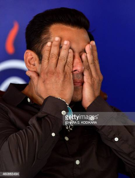 Indian Bollywood film actor Salman Khan gestures at a free medical clinic organised to drum up support for President Rajapakse who is seeking...