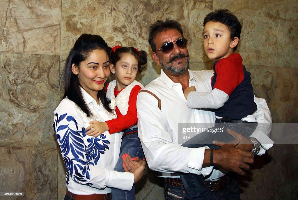 Indian Bollywood film actor <a gi-track='captionPersonalityLinkClicked' href=/galleries/search?phrase=Sanjay+Dutt&family=editorial&specificpeople=1541020 ng-click='$event.stopPropagation()'>Sanjay Dutt</a> (2R) and his family attend the special screenig of Hindi film 'PK' in Mumbai on December 25, 2014. AFP PHOTO