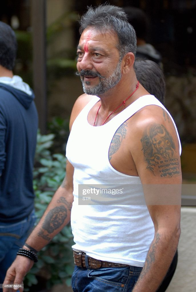 Indian Bollywood film actor <a gi-track='captionPersonalityLinkClicked' href=/galleries/search?phrase=Sanjay+Dutt&family=editorial&specificpeople=1541020 ng-click='$event.stopPropagation()'>Sanjay Dutt</a> arrives at his residence Imperial Heights, Pali Hill Bandra in Mumbai after being granted a 14-day furlough on December 24, 2014. <a gi-track='captionPersonalityLinkClicked' href=/galleries/search?phrase=Sanjay+Dutt&family=editorial&specificpeople=1541020 ng-click='$event.stopPropagation()'>Sanjay Dutt</a> is serving 42 months of his five-year sentence for illegal possession of arms in Yerawada jail, in a case related to the 1993 Mumbai serial blasts, during which over 250 people were killed and several were wounded. AFP PHOTO