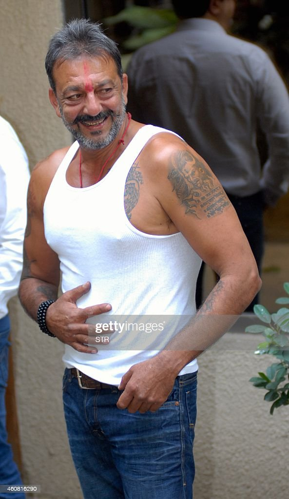 Indian Bollywood film actor <a gi-track='captionPersonalityLinkClicked' href=/galleries/search?phrase=Sanjay+Dutt&family=editorial&specificpeople=1541020 ng-click='$event.stopPropagation()'>Sanjay Dutt</a> poses on his arrival at his residence Imperial Heights, Pali Hill Bandra in Mumbai after being granted a 14-day furlough on December 24, 2014. <a gi-track='captionPersonalityLinkClicked' href=/galleries/search?phrase=Sanjay+Dutt&family=editorial&specificpeople=1541020 ng-click='$event.stopPropagation()'>Sanjay Dutt</a> is serving 42 months of his five-year sentence for illegal possession of arms in Yerawada jail, in a case related to the 1993 Mumbai serial blasts, during which over 250 people were killed and several were wounded. AFP PHOTO