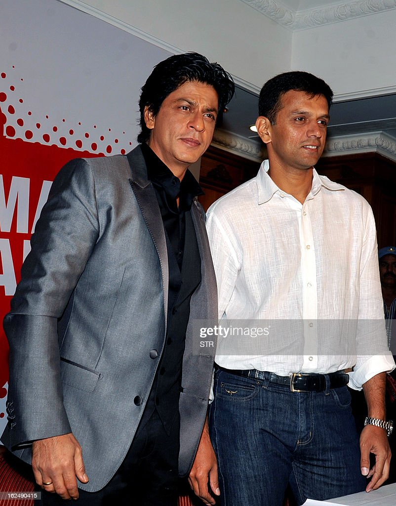 Indian Bollywood film actor Shah Rukh Khan (L) and former Indian cricketer Rahul Dravid attend a press conference on the occasion of the Toyota University Cricket Championship (TUCC) first match of the season in Mumbai on February 23, 2013.
