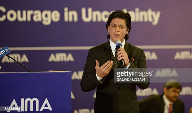 Indian Bollywood film actor Shah Rukh Khan answers a question during the 40th national management convention on 'Courage in Uncertainty' in New Delhi...