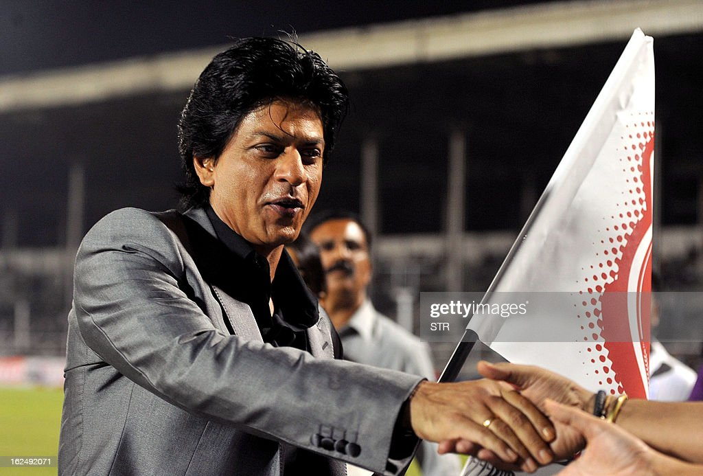 Indian Bollywood film actor Shah Rukh Khan flags the grand opening ceremony of the Toyota University Cricket Championship (TUCC) first match of the season in Mumbai on February 23, 2013.