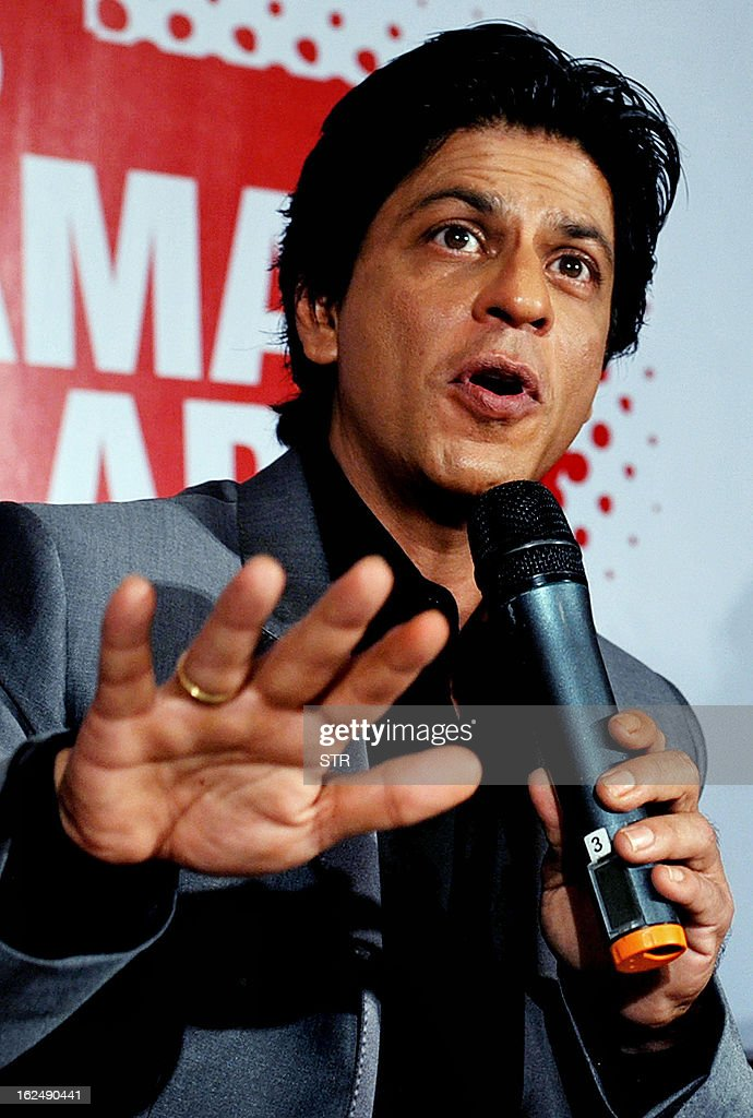 Indian Bollywood film actor Shah Rukh Khan gestures during a press conference on the occasion of the Toyota University Cricket Championship (TUCC) first match of the season in Mumbai on February 23, 2013.