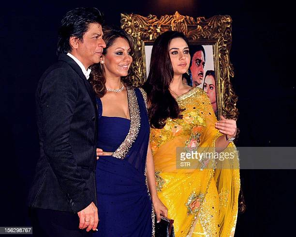 Indian Bollywood film actor Shahrukh Khan his wife Gauri Khan and actress Preity Zinta pose on the red carpet at the premiere of the Hindi film 'Jab...