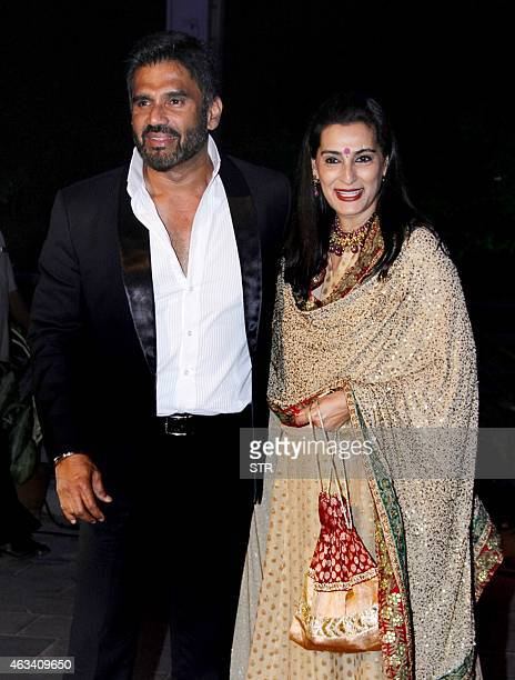 Indian Bollywood film actor Suniel Shetty and wife attend the wedding reception of Bollywood film producer Smita Thackeray's son Rahul Thackeray and...